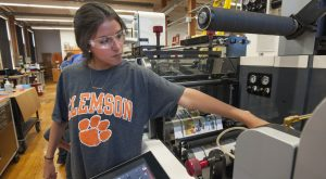 May 12, 2016 - Printing press giant, Nilpeter has completely outfitted a FB-3 13-inch fully automated servo press at Clemson University Graphics Communication Center in Godfrey Hall. Professor Kern Cox and students observed its operation.
